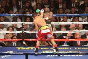 Floyd bends back over rope